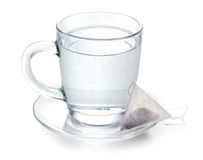 Hot water and teabag Stock Photos