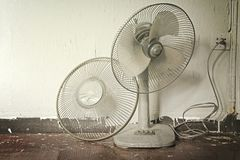 Hot weather. Dirty broken old electric fan in hot weather. stock photos