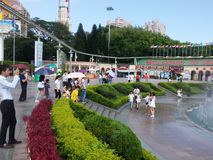 The hot weather, Shenzhen window of the world tourist attractions, there are still a lot of tourists under the scorching sun in th. E play. Tourists or take Stock Photo