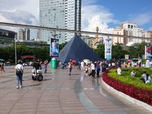 The hot weather, Shenzhen window of the world tourist attractions, there are still a lot of tourists under the scorching sun in th. E play. Tourists or take Royalty Free Stock Image