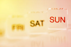 Hot Weekend. Mood shot of calendar days plastic blocks - intentional selective focus (focus on Sunday tile Royalty Free Stock Photography