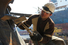Hot welding on an construction area. Hot welding by a worker on an construction area Royalty Free Stock Images