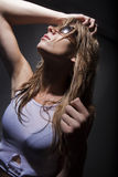 Hot and wet. Beautiful model sweating playing with her wet hair Royalty Free Stock Image