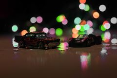 Hot wheels toy cars in low light royalty free stock photos