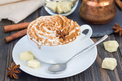 Hot white chocolate, decorated with whipped cream and cinnamon Royalty Free Stock Image