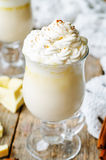 Hot white chocolate decorated with whipped cream with cinnamon. Royalty Free Stock Photography