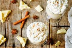 Hot white chocolate decorated with whipped cream with cinnamon Royalty Free Stock Images