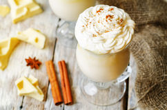 Hot white chocolate decorated with whipped cream with cinnamon Stock Image