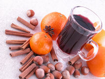 Hot wine. Glass of hot wine, spices, oranges Royalty Free Stock Photo