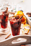 Hot wine aroma drink with spices in tall glasses Royalty Free Stock Photo