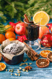 Hot wine drinks with spicy and sweet arrangement, Shot on old wo Stock Photography