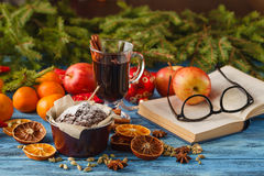 Hot wine drinks with spicy and sweet arrangement, Shot on old wo Royalty Free Stock Photo