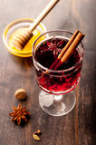 Hot wine (mulled wine) with spices and honey Stock Photo