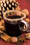 Hot Wine Punch. With Christmas decoration as closeup on red background Royalty Free Stock Images
