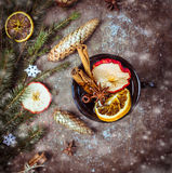 Hot wine punch with dried fruit on christmas decoration Royalty Free Stock Photos
