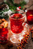 Hot wine punch with ingredients for Christmas