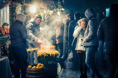 Hot wine seller on a christmas market Royalty Free Stock Image