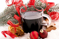 Hot wine in Snow. Hot wine punch with Christmas decoration as closeup in snow Royalty Free Stock Photo