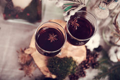 Hot Wine. Two glasses of hot wine with star anise inside on the wooden stump Royalty Free Stock Images