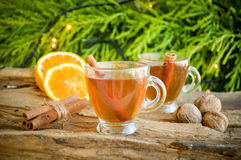 Hot wine for winter and Christmas with delicious orange and spices Royalty Free Stock Images