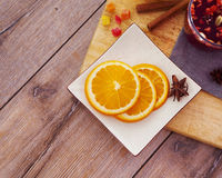 Hot wine for winter with delicious orange and spices Stock Images