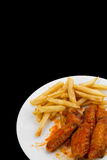 Hot Wings and Fries. Hot Chicken Wings and Fries Isolated on Black Background stock photos