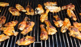 Hot wings on the grill. Hot wings cooking on an outdoor grill Stock Image