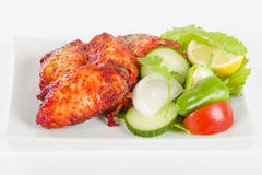 Hot Wings. Spicy and hot chicken wings served with salad on a white background stock images