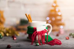 Hot winter beverage in a mug with warm scarf Royalty Free Stock Image