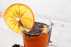 Hot winter drink with spices and orange, close-up Stock Photos