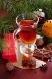 Hot winter drinks. Black tea with lemon, cinnamon, star anise se Stock Image