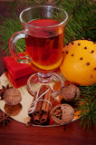 Hot winter drinks. Black tea with lemon, cinnamon, star anise se Royalty Free Stock Image