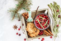 Hot winter mulled wine with cranberries and spices in a wooden b Stock Photography