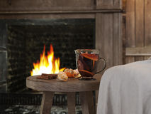 Hot winter tea and background with fireplace. 3D RENDERING Stock Photo