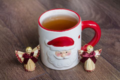 Hot winter tea in a red mug. Tea break preparing for  festivities Stock Photography