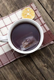 Hot winter tea on a wooden table Stock Image