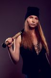 Hot woman bandit with baseball bat Stock Image
