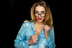 Hot woman with beautiful makeup in glasses and jeans shirt in st Royalty Free Stock Photo