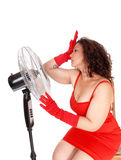 Hot woman with big fan. Royalty Free Stock Photography