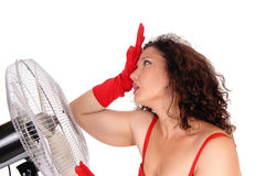 Hot woman with big fan. Royalty Free Stock Images