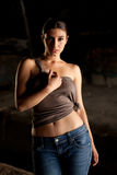 Hot woman with blue jeans. And brown top Stock Photography