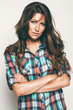 Hot woman in check shirt. In studio Royalty Free Stock Photos