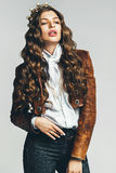 Hot woman in leather jacket and golden crown Stock Photos