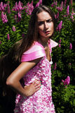 Hot woman in pink dress with flowers Royalty Free Stock Photo