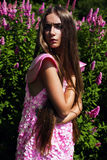 Hot woman in pink dress with long hair Stock Photography