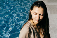 Hot woman relax near swimming pool,toned skin,sunglasses,vacatio Royalty Free Stock Photography