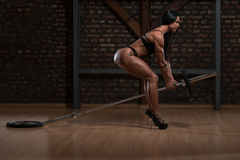 Hot Woman In Underwear Doing Exercise For Back. Young Woman In Underwear Doing Heavy Weight Exercise For Back With Barbell royalty free stock photos
