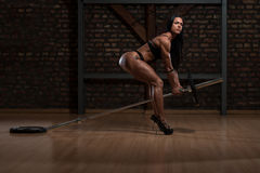 Hot Woman In Underwear Doing Exercise For Back. Young Woman In Underwear Doing Heavy Weight Exercise For Back With Barbell royalty free stock images