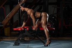Hot Woman In Underwear Doing Exercise For Back. Young Woman In Underwear Doing Heavy Weight Exercise For Back With Dumbbell stock photography