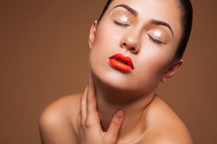 Hot woman with wet make up in studio Royalty Free Stock Photo
